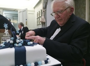 Dr. Pelczynski cuts his birthday cake – 90 years young!