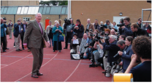 Sir Roger greets the world's media at the Iffley Road track on the 50th anniversary of his historic run, May 6, 2004